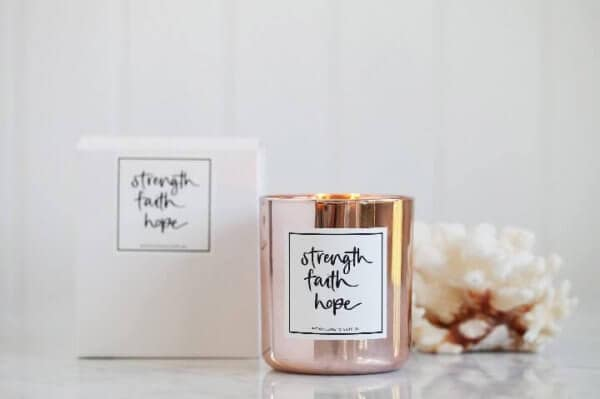Lemon Canary's rose gold 'Strength Faith Hope' soy candle with box and white coral behind