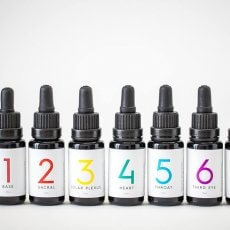 Set of 7 Chakra organic essential oil blends in 15ml black miron glass bottles with droppers