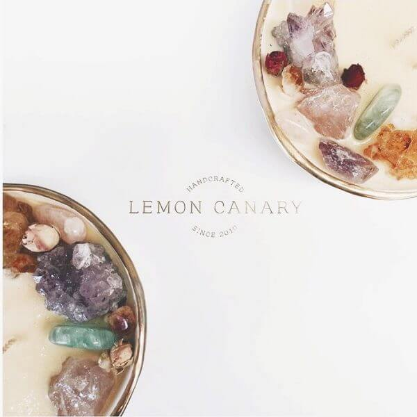 Lemon Canary crystal soy candle bowls with gold foil Lemon Canary logo in between.