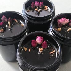 Group Of 4 Love And Gratitude Soy Candles In Black Miron Glass With Rose Buds And Petals
