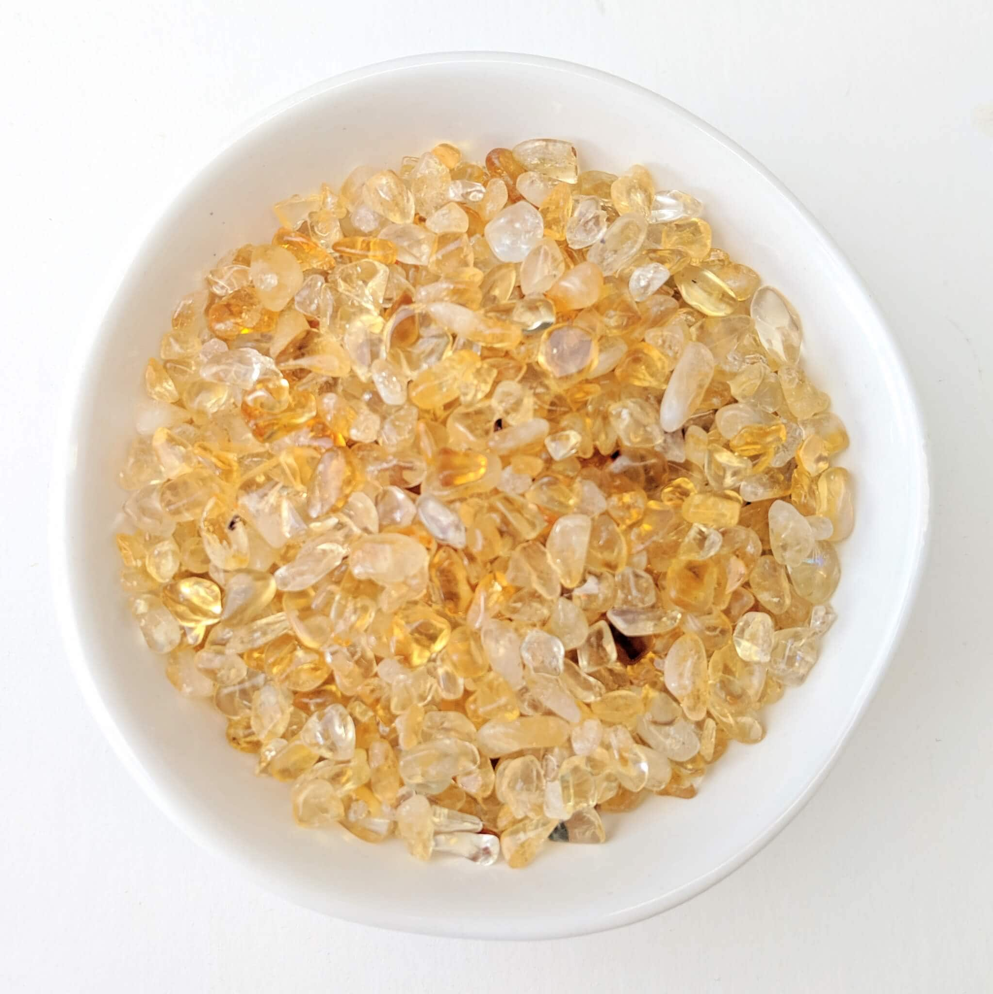 Citrine Crystal Chips in a White Bowl Top View